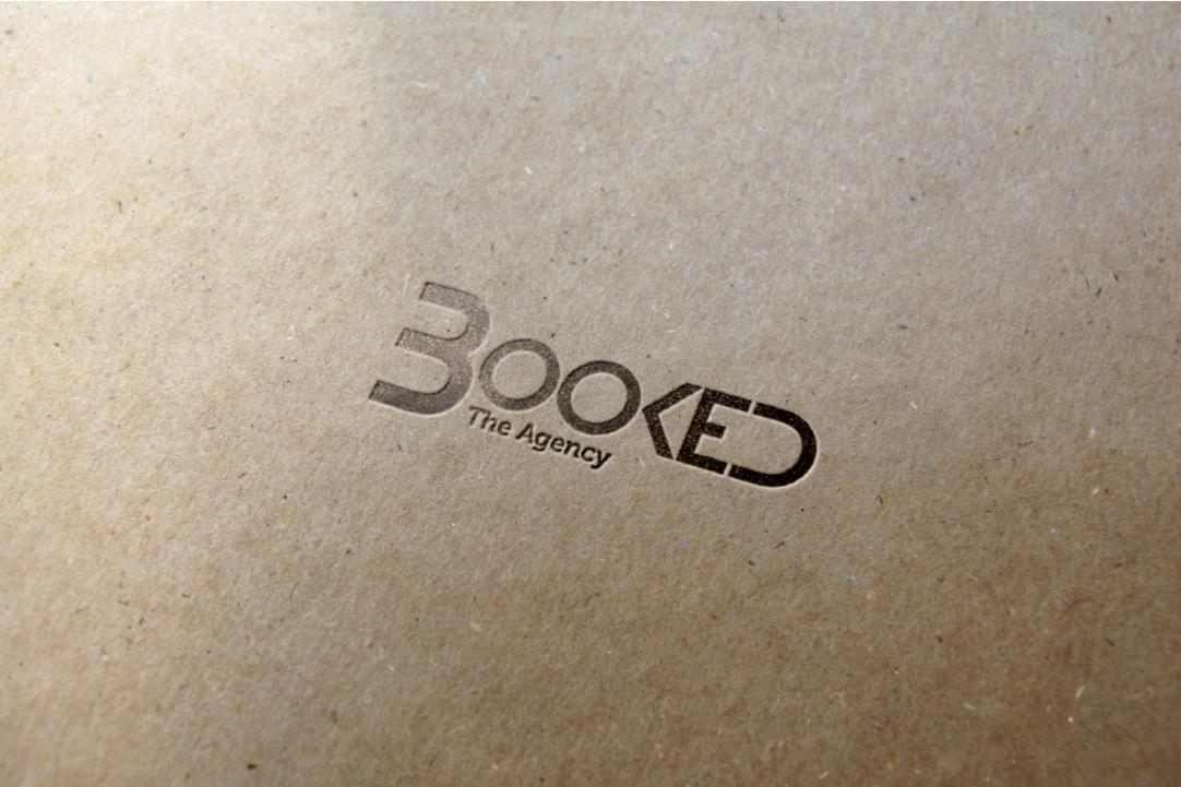 BOOKED: The Agency Logo