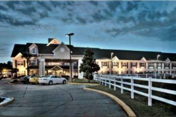 Country Inns & Suites Ocean Springs Logo