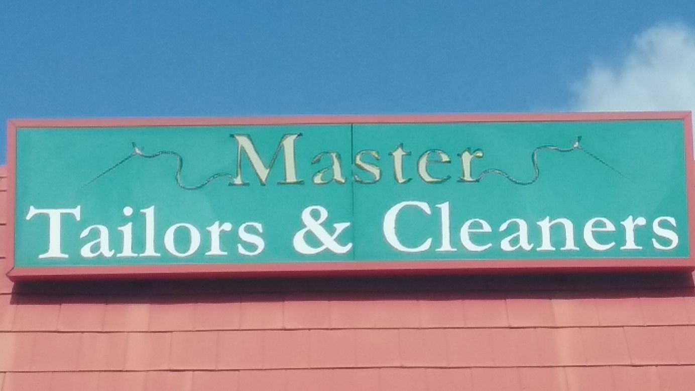 Master Tailors and Cleaners Logo
